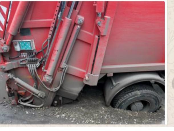 На «классных» дорогах Таганрога пострадал мусоровоз «Экотранса»